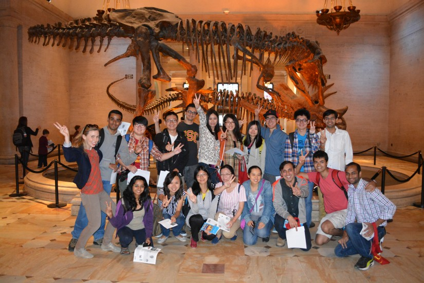 students with dinosaurs